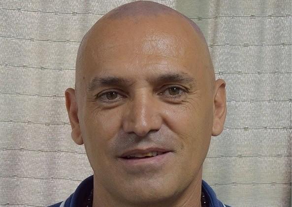 Adrian Caporales: